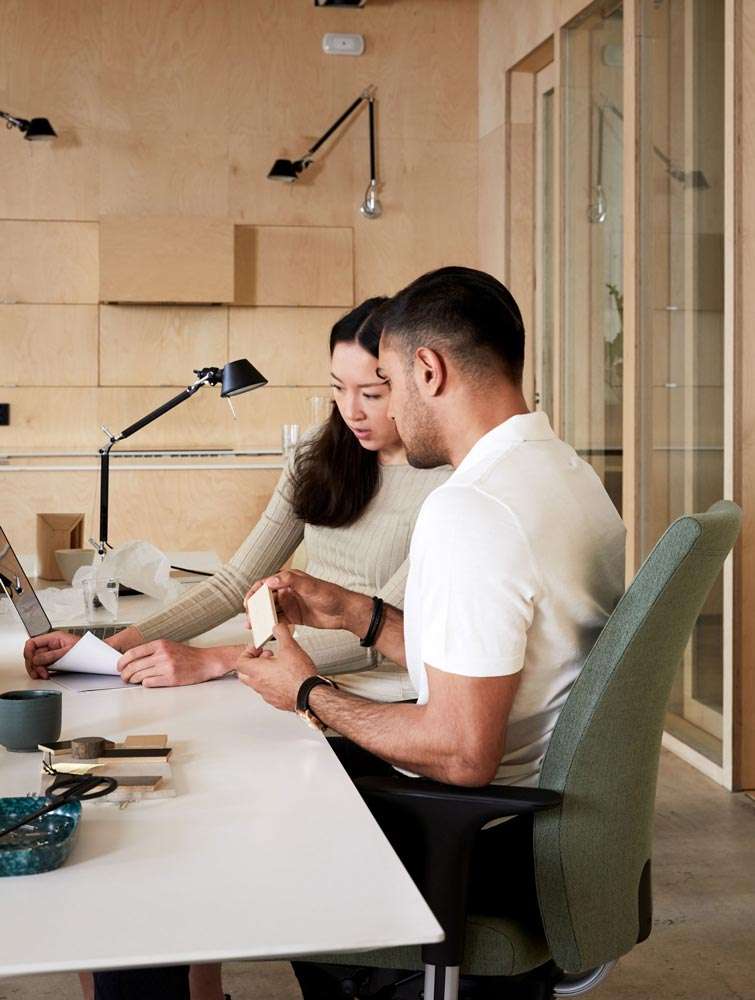 two people sitting at desk